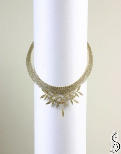 Necklace No. 10217      Gold, dark gold and Swarovski crysta.  lPrice: € 63  Other color variations are in the catalog.   ............................   Protected by copyright!