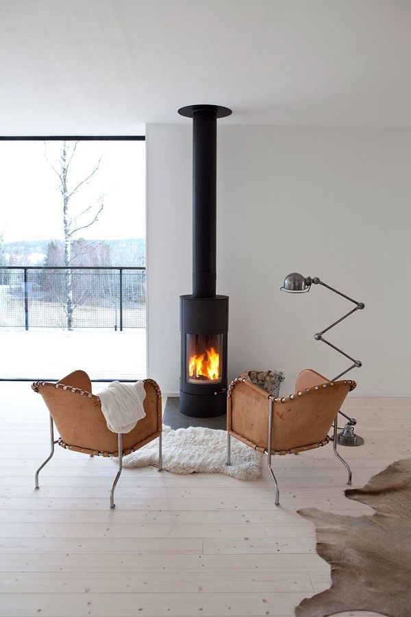 Love this fireplace! The link is to a sweetish design site. Would love to find something like this in the US.