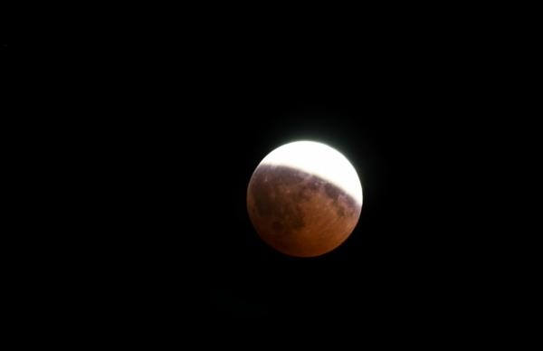 Types of Solar and Lunar Eclipses. Partial lunar eclipse in 2008 seen in Germany.   ©iStockphoto.com/cinoby