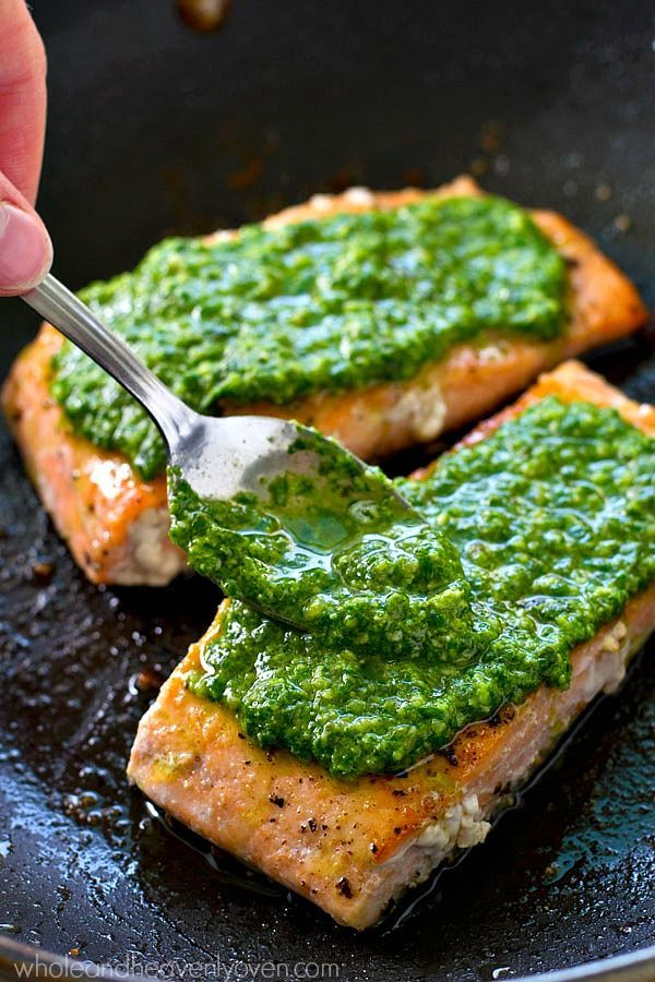Simple pan-seared salmon is smothered in a flavorful spinach basil pesto sauce…