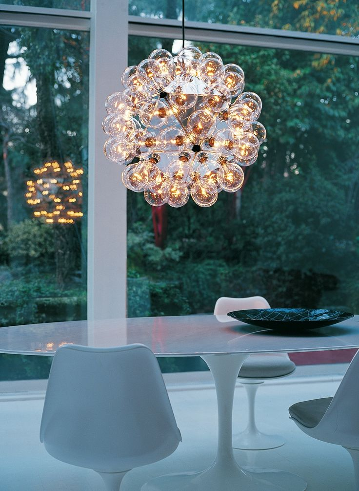 Taraxacum 88 by Achille Castiglioni for FLOS is a whimsical decorative chandelier perfect for a modern dining room.