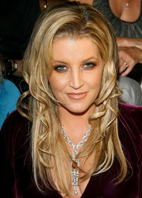 Lisa Marie Presley. I know she is her own person and I love her records as they stand alone,  but her eery similarity to Elvis endears me still...