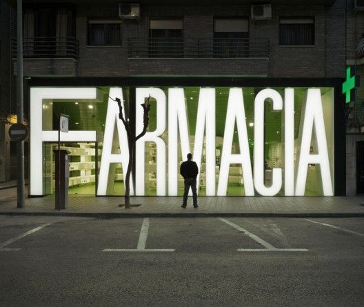 Great environmental typography as entire storefront. CLAVEL ARQUITECTOS, CASANUEVA PHARMACY MURCIA SPAIN #signage #egd