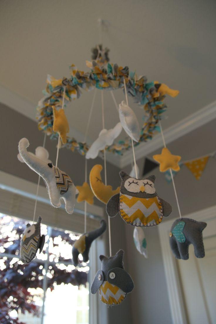 Baby room, nursery, teal nursery, yellow nursery, grey nursery, wall mural, wall decal, painted changing table, grey crib, Pom Pom balls, mobile, owl, elephant, giraffe, monkey, bird