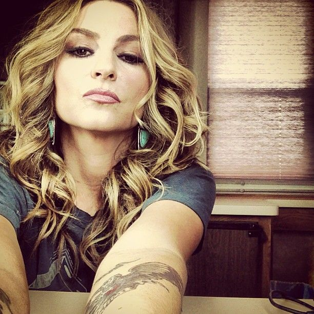 I'm on a mission to find out who makes and where I can find the turquoise and sterling silver earrings Drea De Matteo wears throughout Sons of Anarchy! Please help! (photo via @dreadematteo - IG)
