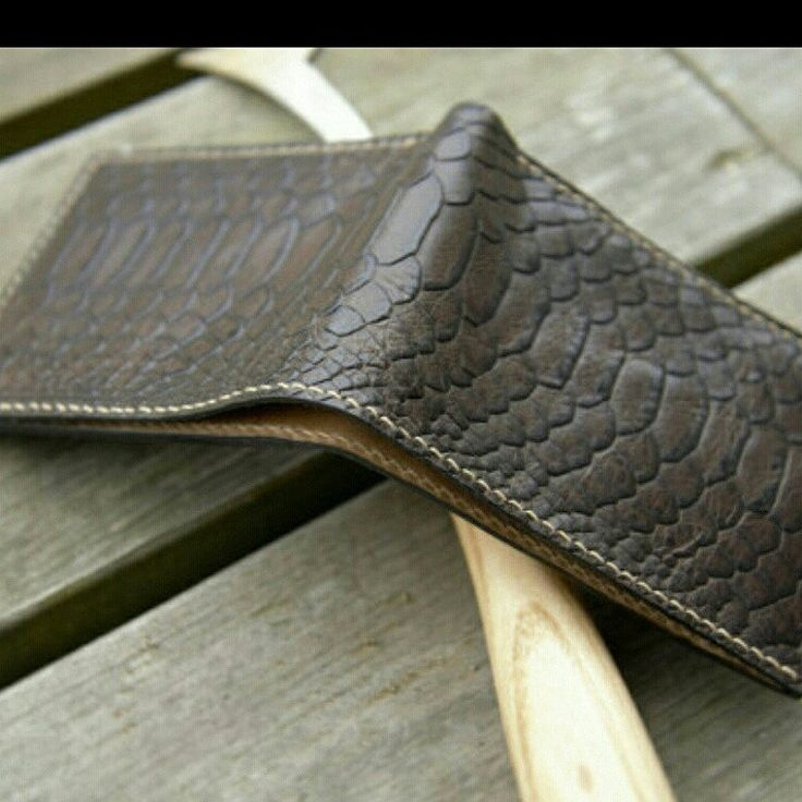 Our new product. Python print leather bifold wallet, flawlessly hand crafted and hand stitched...