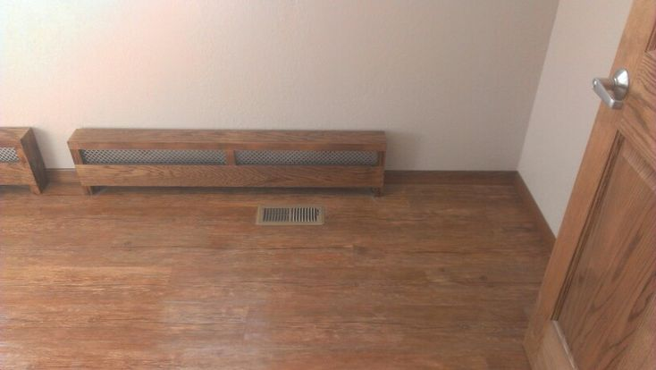 Wood baseboard heater vent cover.