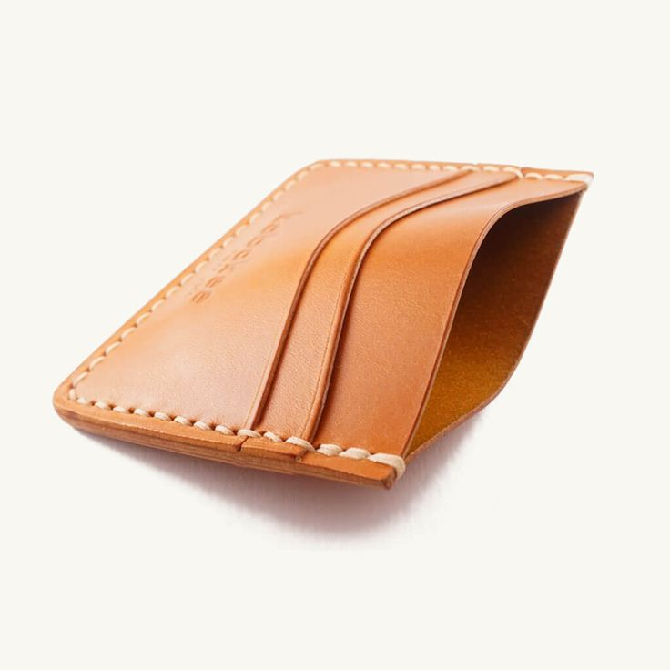 Our leather card holder wallet is the ideal piece to downsize to just the essentials such as your ID, a couple debit cards, and folded bills in the cash pock