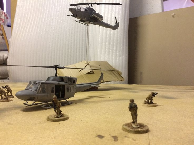 USMC helo insert under cover of gunship concept , I want to reshoot this once I have completed the terrain .   1:48 uh1n low visibility decals   1:48 ah1w low visibility decals  28mm USMC Figures