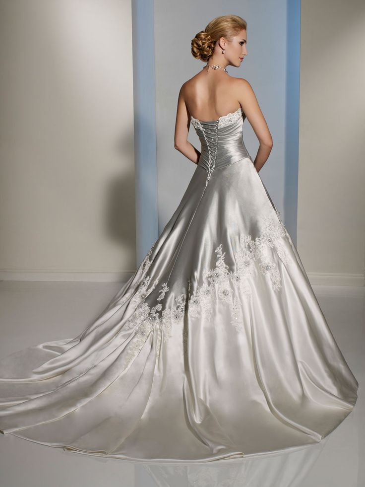 silver and white draped bodice wedding dress