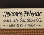 Take Your Shoes Off and stay awhile primitive wood sign. $14.00, via Etsy.