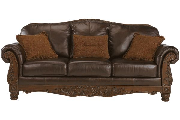 Traditional Leather Sofa with Show Wood Accent by Ashley Furniture | Chicago Leather Furniture