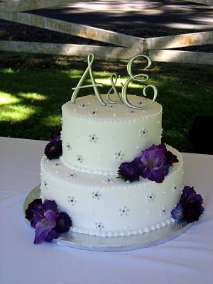 love initials instead of the traditional people  as cake toppers
