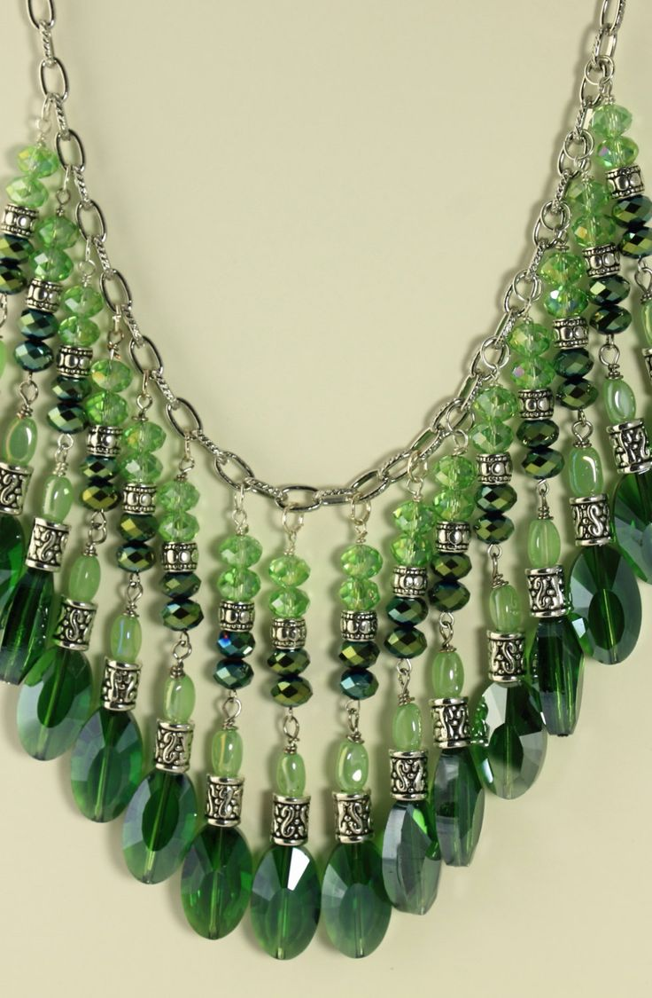 Handmade emerald green statement bib necklace! Large faceted emerald green ovals combined with opaque light peridot green 6x10 mm rice beads