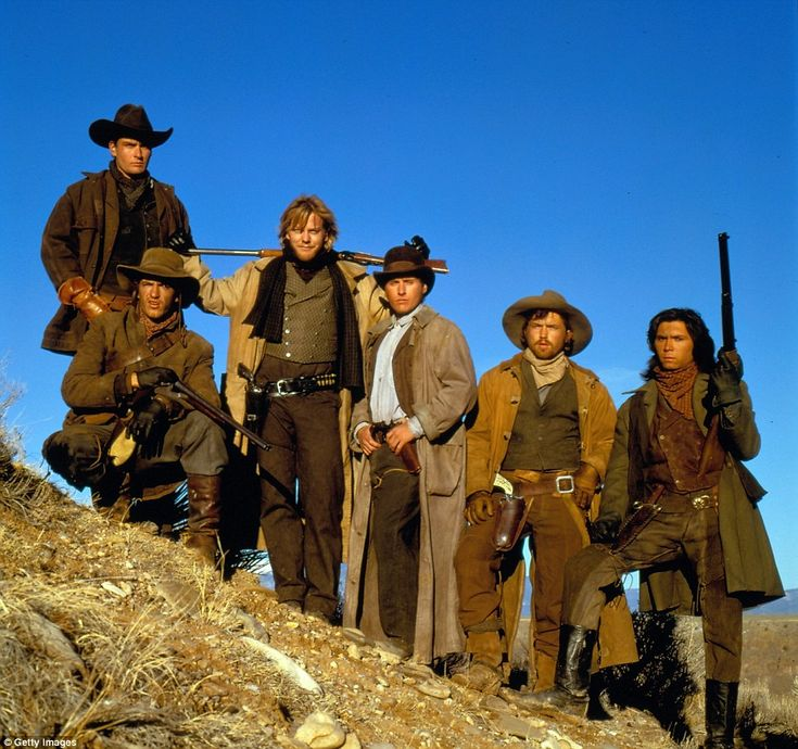 Young guns: The Regulators crew was feature in the 1988 film Young Guns, with Billy the Kid played by Emilio Estevez (third from right) and Charlie Bowdre paid by Casey Siemaszko (second from right)... and Keifer Sutherland doing a fine impression of his father