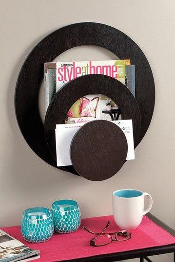 Wall mounted magazine holder