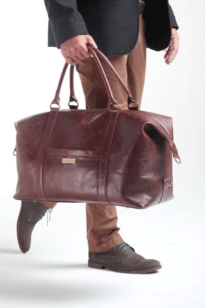 Finest hand selected distressed bovine leather Canvas waterproof lining in brown Inside zipped pocket and spacious main compartment 1 flat exterior pocket Double carry handles reinforced for a comfortable hand-held Removable & adjustable leather shoulder strap Metal feet underneath for protection Hand crafted in South Africa L 60cm x H 36cm x W 22cm ( cabin size) Delivery within 3 - 5 working days