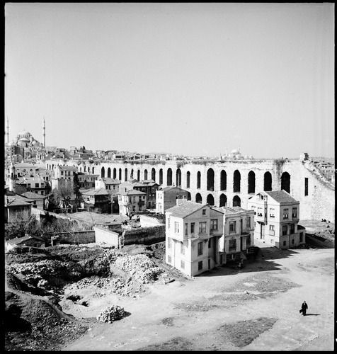 Aqueduct of Valens (Bozdoğan Kemeri) with Fatih Camii rising at the vanishing point of the aqueduct line, March 1936. The fresh debris of recently demolished buildings in the foreground is testimony of the dynamism of a major center of population like Istanbul. Based on the exhibit Artamonoff: Picturing Byzantine Istanbul, 1930–1947, organized by the Koç University and Dumbarton Oaks, Washington DC, Trustees for Harvard University