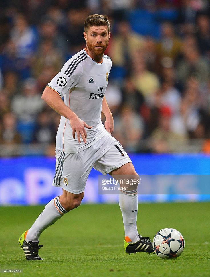 Xabi Alonso of Madrid in action during the EEFA Champions League round of 16 second leg match between Real Madrid CF and FC Schalke 04 at Estadio Santiago Bernabeu on March 18, 2014 in Madrid, Spain.