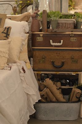Stacked vintage suitcases, always perfect accents for a farmhouse or cottage!...extra storage too!!!
