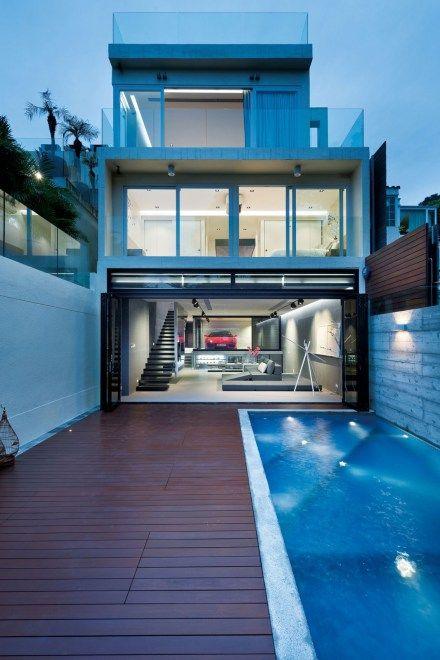 Split-Level House Centered Around a Red Ferrari | Tanusha