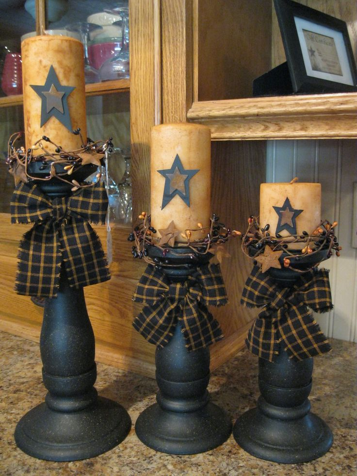 May have to hit the junk stores for some old candle holders to paint and the $ store for candles grundgy up the candles decorate add rag bow,cheap cheap!!!