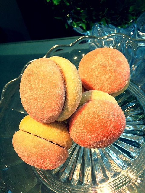 Breskvice, Croatian Peach Cookies.  Cookie filling is walnuts, cookie crumbs, apricot jam and rum. Then dipped in peach brandy and food coloring and rolled in sugar. #food #peach #croatia