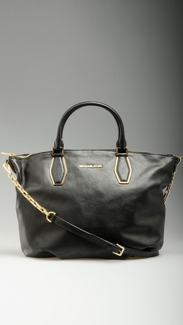 Vanessa black goat skin leather tote bag featuring top zip, tote handles, monogram lining, four inner open pockets and a zippered one, golden chains embellished crossbody strap, golden hardware, 16.9'' x 5.1'' x 11'', 100% goatskin.