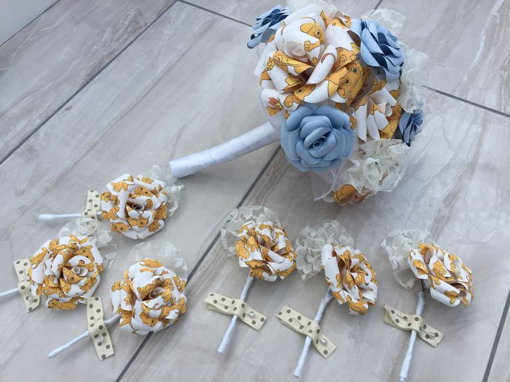 Custom made baby lion and pale blue bridal bouquet with added lace flowers and matching buttonholes  Www.facebook.com/DianaSianCrafts Www.etsy.com/uk/shop/DianaSianCrafts
