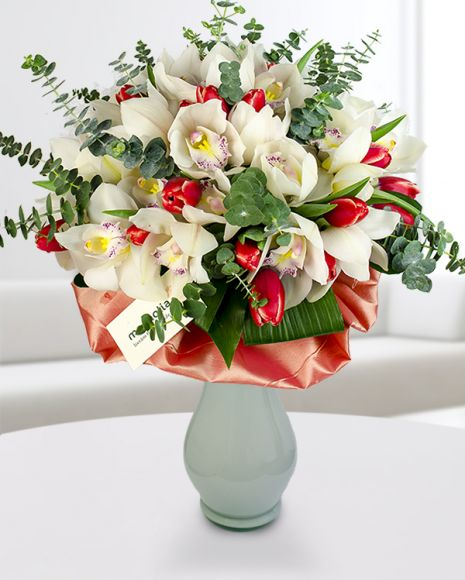 Looking for a stylish, glamorous Valentine's bouquet to surprise your loved one? Our florists have designed a bouquet of cymbidium orchids, tulips and scented eucalyptus , perfect for such a special day. Order Valentine's flowers and we assure you that this day would be different. All you have to do is place your order online and we can help you with flower delivery.