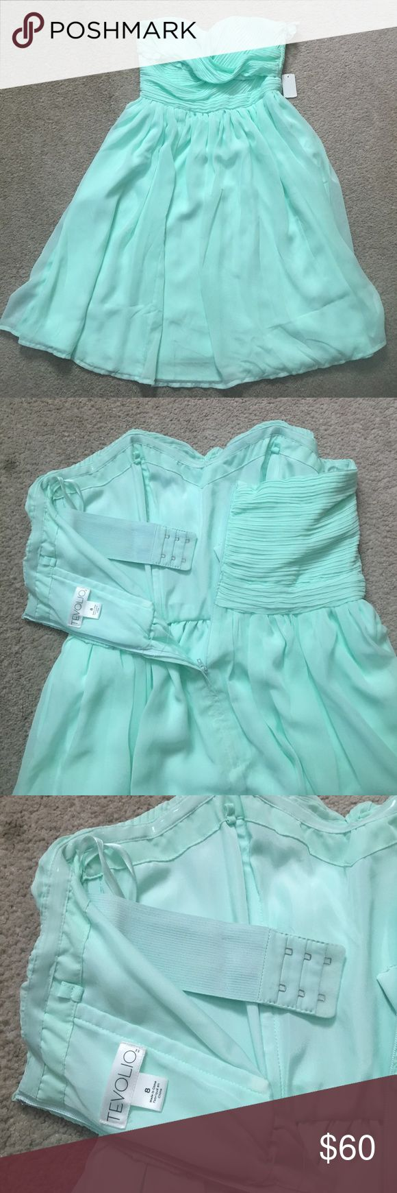 Brand new strapless mint colored dress Beautiful mint green strapless dress, with built in bra.  Perfect for a nice evening out, cocktail party, formal event, or homecoming!  It's brand new with tags still attached. Dresses