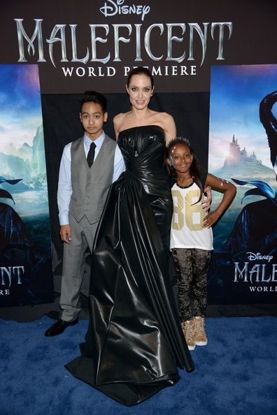 Angelina Jolie Actress Angelina Jolie (C) with children Maddox Jolie-Pitt (L) and Zahara Jolie-Pitt attend the World Premiere of Disney's 'Maleficent', starring Angelina Jolie, at the El Capitan Theatre on May 28, 2014 in Hollywood, California.
