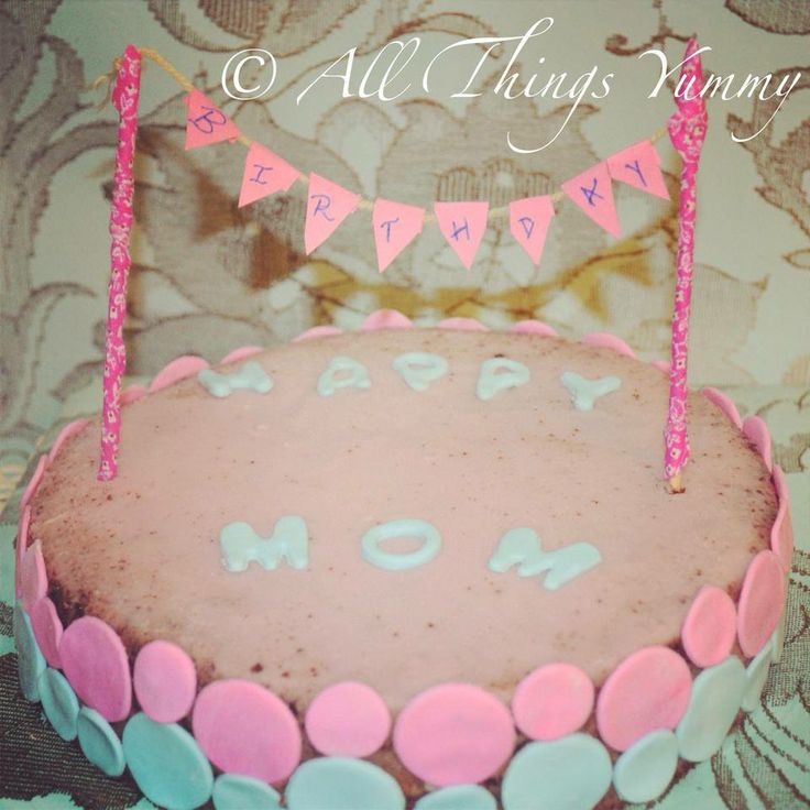 Birthday cake for a very special #mommy... #birthday #mom #bunting #circles #pink #blue #buttercream #irishcream #chocolatefudge #cake #designercake #homebakery #girlie #cute #flags #allthingsyummy #zomato
