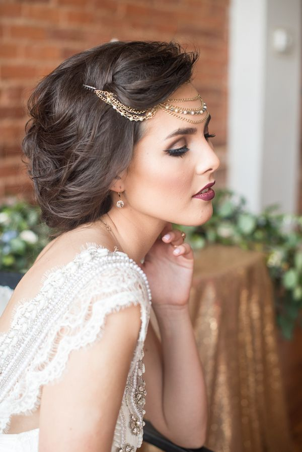 Glam up-do accented with gold headpiece. View the full wedding here: http://thedailywedding.com/2016/07/26/gatsby-glam-wedding-inspiration/