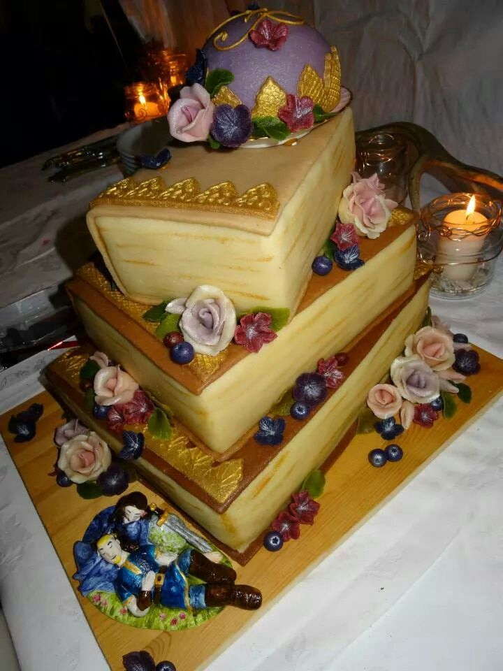 Making my own wedding cake. :) completely covered in marzipan, with roses, flowers and gold lettering.