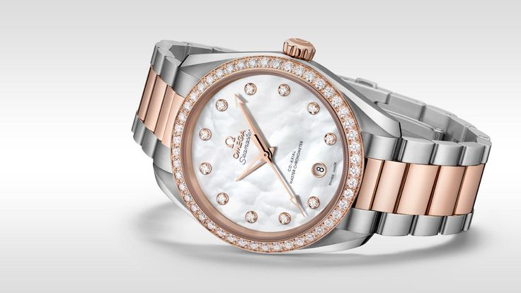 Encircled by diamonds, the ladies' Seamaster Aqua Terra is the true definition of elegance. With a symmetrical 38 mm case, this stainless steel and 18K Sedna™ gold model features a white pearled mother-of-pearl dial with a date window at 6 o'clock and 11 diamond indexes in 18K Sedna™ gold holders. The bezel is diamond-set and the watch is presented on an integrated stainless steel and 18K Sedna™ gold bracelet. Driven by the OMEGA Co-Axial Master Chronometer calibre 8800, this wristwatch i...