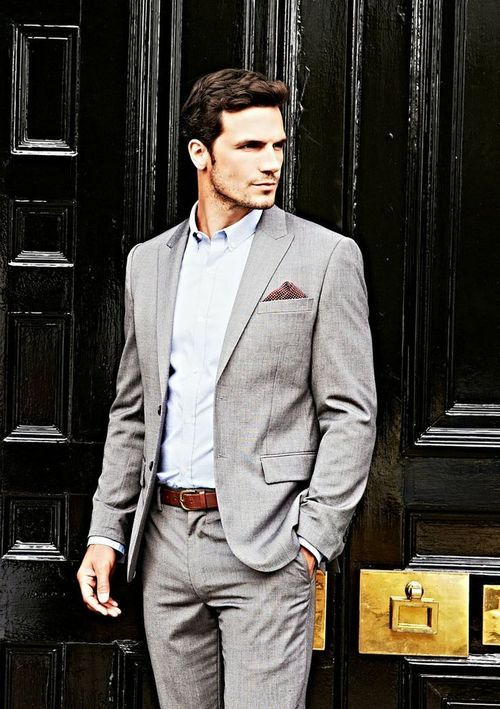 Pale grey suit with an even paler blue tailored shirt and brown accessories.