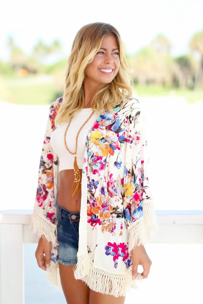 The PERFECT complement for your look is this beautiful Ivory Floral Kimono. It will surely make heads turn! This lightweight piece will be your new fave item! We just love the floral print and the cut