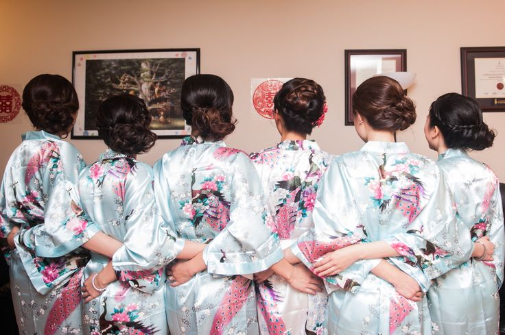 My bridesmaids ended up with the same hairstyle, with the side bun on the opposite side of the one shoulder strap of their dresses. Love the braids an...