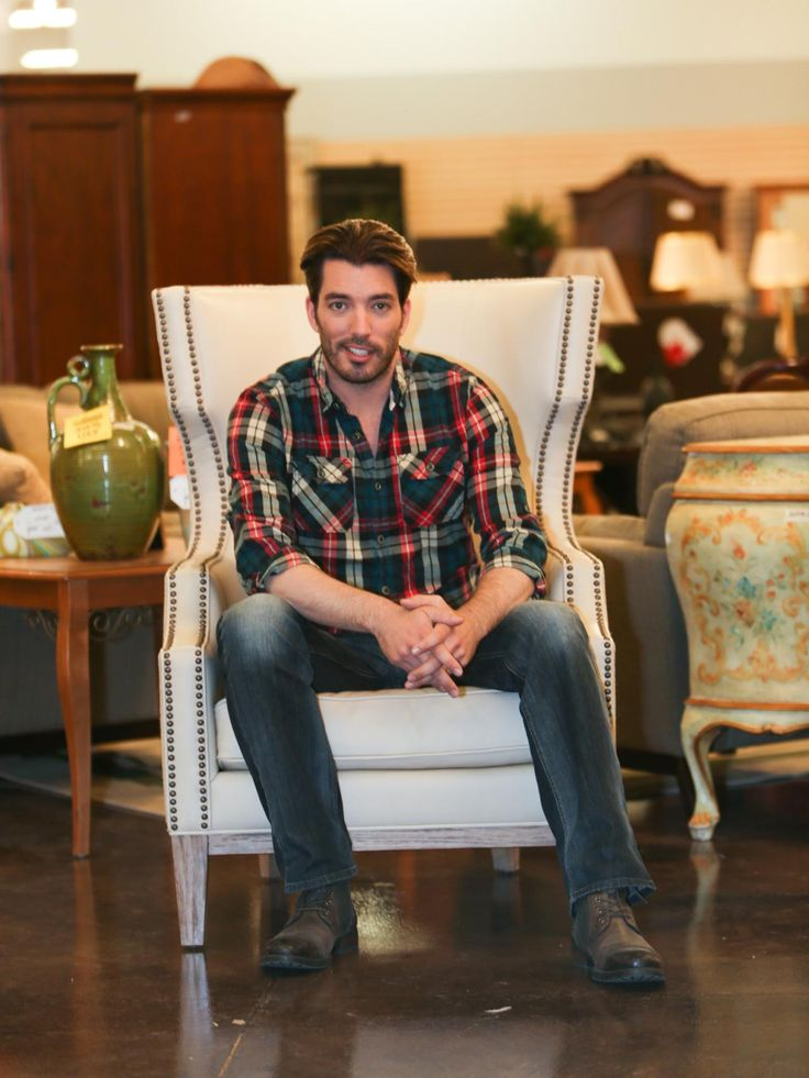 Jonathan Scott, co-host of HGTV's Property Brothers at Home, takes a seat while shopping at Colleen's Consignment in Las Vegas.