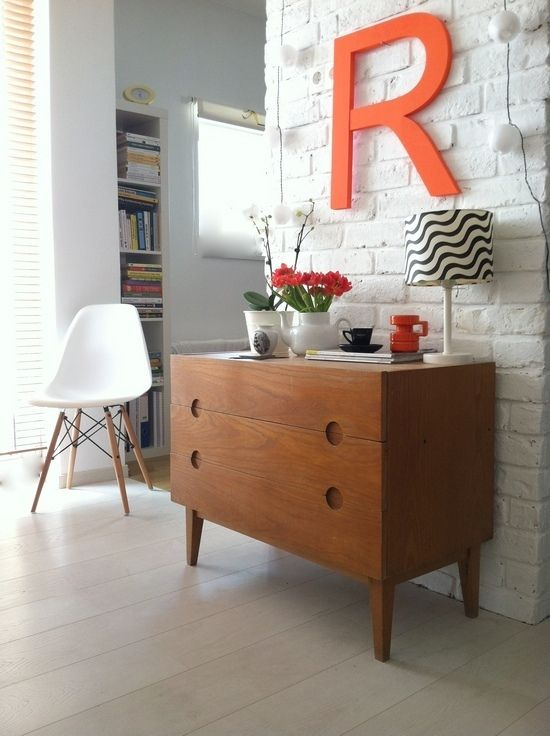 love the eclectic feel. white painted brick, colored letter and vintage desk