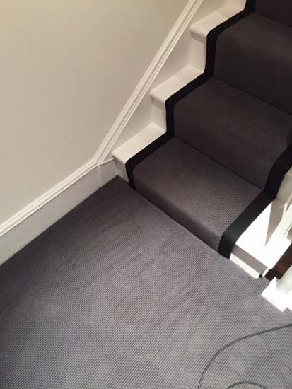 Client: Private Residence In East London Brief: To supply & install grey carpet with black borders as a stair carpet runner