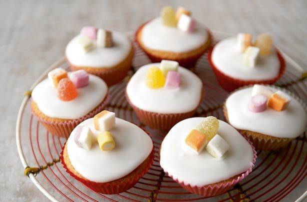 Mary Berry's iced fairy cakes are so easy to make using store cupboard ingredients and they area ready in 30 minutes! This easy recipe shows you how to make a batch of 12 simple fairy cakes and how to decorate them with a simple icing and sweets. Get the kids to help you make these tasty fairy cakes; they can learn how to crack eggs and make smooth icing to drizzle on top of your mini sponges. This recipe couldn't be easier, but comes out perfectly every time - and everyone loves a fairy…