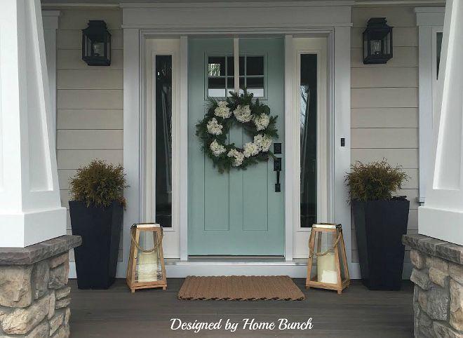 wooden front door, greige siding, blue pots - Google Search