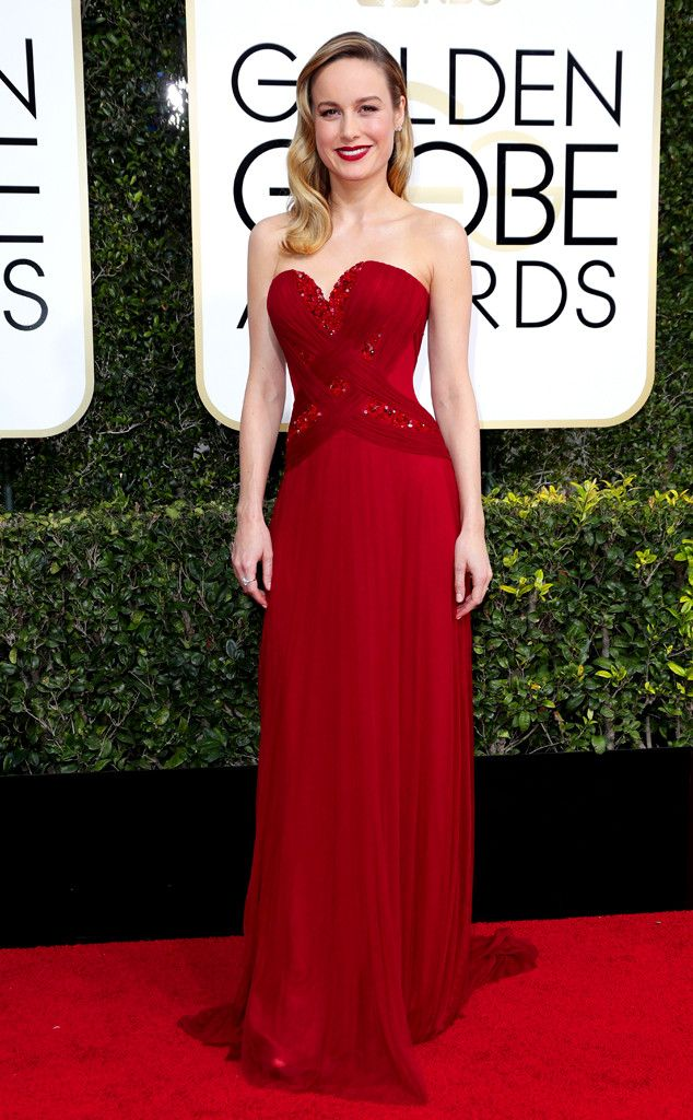 Brie Larson in a long strapless rose red evening gown with a beautiful beaded bodice, and hair in a classic-style sleek wave.