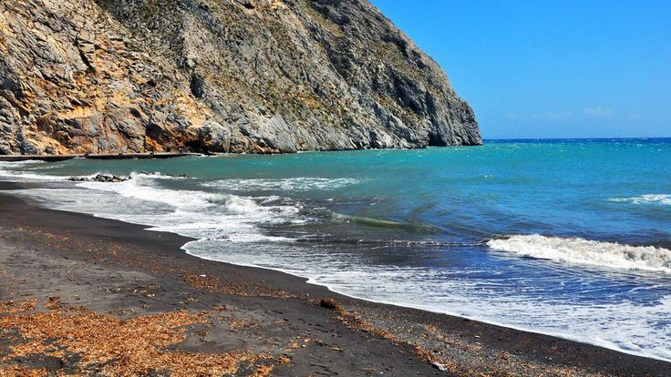 Santorini is home to several black-sand beaches, like the one at Perissa, shown here. Most of Santorini's visitors stay in the island's capital of Thira - or on cruise ships - and few travelers make the 10km trip to Perissa. As a result, the beach isn't just picturesque (and, thanks to its dark shade, unusually warm to lie on), but it is often surprisingly quiet - at least outside of high season, from June to September.   http://esperas-santorini.com/  #santorini #beach #greece #color