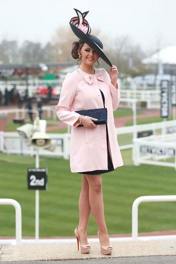 Cheltenham Festival: Jennifer Wrynne from Ireland wears Louboutin heels and a thigh-length pink coat Picture: PA