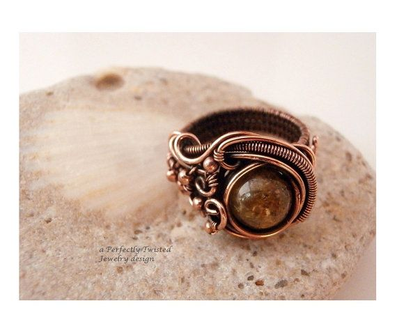 Hey, I found this really awesome Etsy listing at https://www.etsy.com/listing/201621362/wire-wrap-ring-size-7-green-garnet-stone