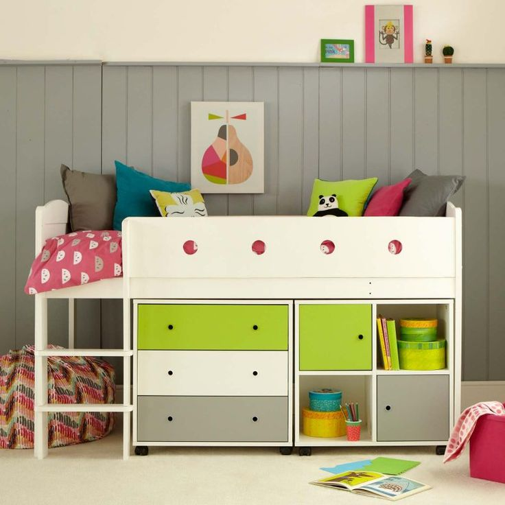 Oodles of storage with a chest of drawers and a storage cupboard with two doors under a full size bed.