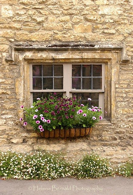 i love everything about this. the stone, the window, and the flower box.